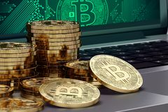 Close-up shot on Bitcoin piles laying on computer. Bitcoin growth concept Royalty Free Stock Photos