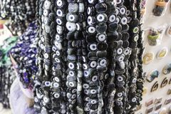 Close-up shot of black bead worn against the evil eye in turkish bazaar for many traditional ancient beliefs royalty free stock images