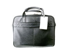 Close up shot of a black leather briefcase with a tag on a white background Royalty Free Stock Photography