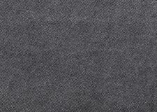 Close up shot of black worn denim jeans fabric Royalty Free Stock Images