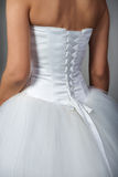 Fragment of a wedding dress Royalty Free Stock Photography