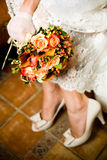 Close-up shot of bride holding bouquet Royalty Free Stock Image