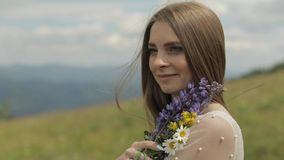 Close up shot of brides face. Bride in wedding dress stay with bouquet stock video