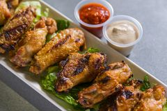 Close up shot of chicken wings. Close up shot of brown crispy chicken wings stock photos