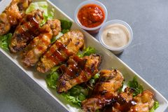 Close up shot of chicken wings. Close up shot of brown crispy chicken wings stock photography