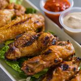 Close up shot of chicken wings. Close up shot of brown crispy chicken wings royalty free stock photos