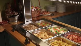 Close up shot of a buffet with a variety of food in containers, nutritious foods stock video