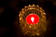 Close up of shot burning candle. Close up shot burning candle inside glass jar  on black background Stock Images