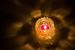 Close up of shot burning candle. Close up shot burning candle inside glass jar  on black background Royalty Free Stock Photography