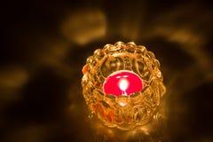Close up of shot burning candle. Close up shot burning candle ine glass jar  on black background Royalty Free Stock Photo