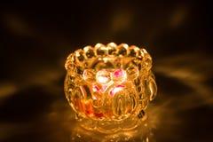 Close up of shot burning candle. Close up shot burning candle inside glass jar  on black background Stock Photo