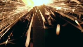 Macro burning sparkler. Close-up shot of a burning sparkler on black background stock video