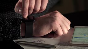 Close up shot of the businessman hand, who checks the message on smart watches stock video