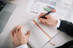 close-up shot of businessman writing stock photos