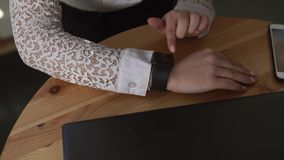 Close up shot of a businesswoman hands using a smart watches. stock footage