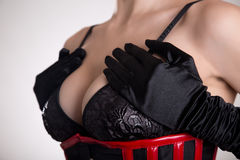 Close-up shot of busty fetish woman in black bra Royalty Free Stock Image