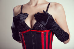 Close-up shot of busty fetish woman in black bra and corset Stock Photography