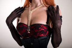 Close-up shot of a busty redhead woman in vintage red bra and sh Stock Photos