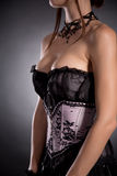 Close-up shot of a busty woman in elegant Victorian corset Stock Images
