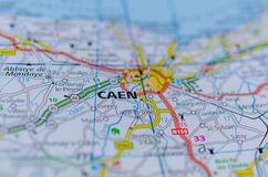 Caen on map. Close up shot of Caen  on map, Caen is a port city and capital of Calvados department in northern France`s Normandy region Royalty Free Stock Images
