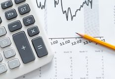 Close up shot of calculator, graphs, pencil Royalty Free Stock Image