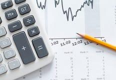 Close up shot of calculator, graphs, pencil royalty free stock image