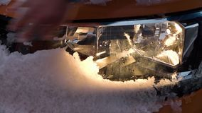 A car`s headlight with snow. A close up shot of a car`s headlights coated with snow stock video