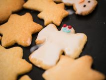 Close-up shot of christmas angel cookie with funny face painted royalty free stock photography