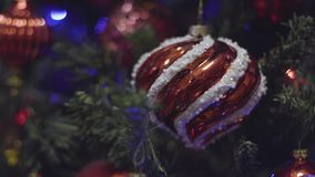 Close up shot Christmas and New Year Decoration. Abstract Blurred Bokeh Holiday Background. Blinking Garland. Christmas stock footage