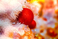 Close-up shot of Christmastide decoration with red balls and whi Royalty Free Stock Photo