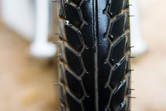Close-up shot of classical motorcycle tire tread in wet weather condition Royalty Free Stock Photos