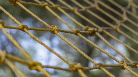 Rope wall at an adventure park - close up stock photo