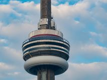 Close up shot of the CN Tower with clouds timelapse