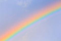 Close up shot of colorful rainbow. Over the blue sky Royalty Free Stock Photo
