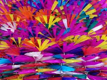 Colorful toy windmills backgrounds Stock Images