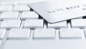 Close up shot of credit card on a keyboard Royalty Free Stock Photography