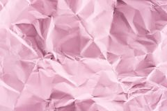 Close-up shot of crumpled pink paper. For background stock image