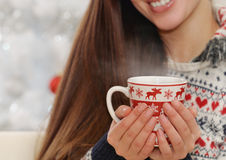 Close up shot of cup in woman's hands with hot drink on Christma Royalty Free Stock Photography