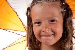 Close-up shot of cute little girl with umbrella Royalty Free Stock Image