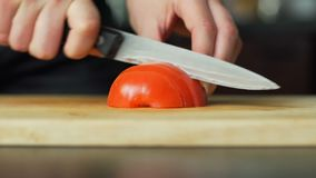 Woman cutting the tomato stock footage