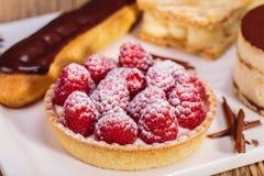 Close up shot of Delicious raspberry mini tarts with fresh raspb Stock Image