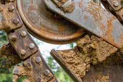 Close up shot of a digger. Caked in mud royalty free stock photography