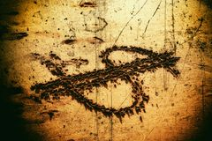 Dollar sign drawing on beach. Close up shot of dollar sign drawing on beach Royalty Free Stock Images
