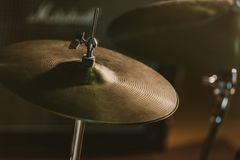 Close-up shot of drum cymbal under spotlight. On stage royalty free stock photos