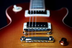 Electric Guitar Bridge Pick Up, Tailpiece and Strings stock photo