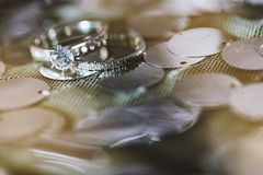An engagement rings of bride and groom focused on the diamond head stock photography