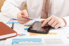 Young businessman working with modern devices Stock Photos