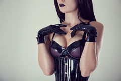 Close-up shot of female breasts in latex bra Royalty Free Stock Photos