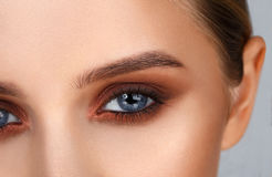 Close-up shot of female eye make-up in smoky eyes style Stock Photography