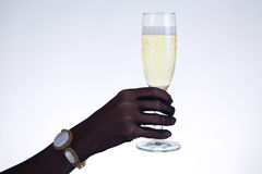 Close-up shot of female hand holding champagne glass Stock Photo